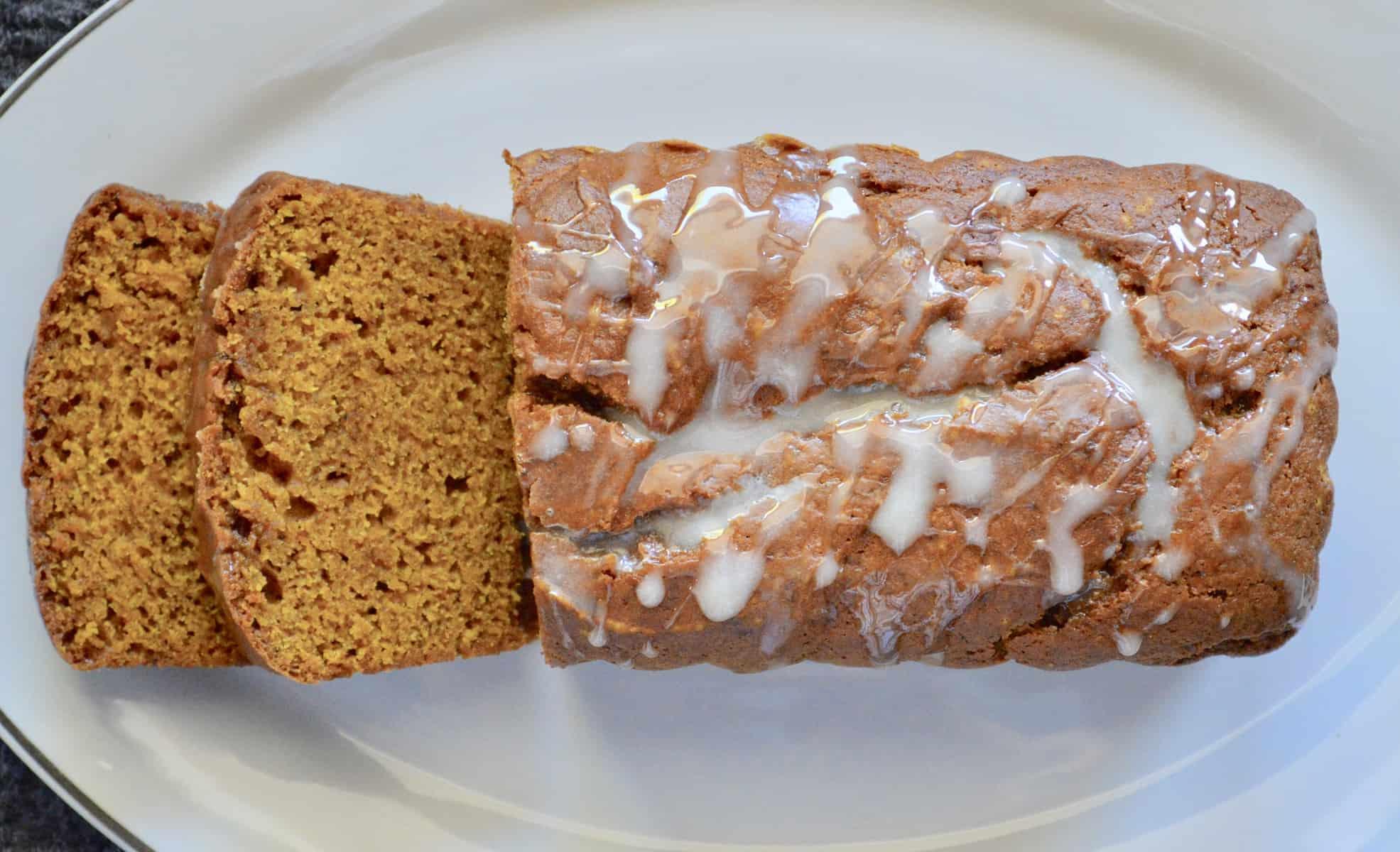 glazed pumpkin bread on a white platter