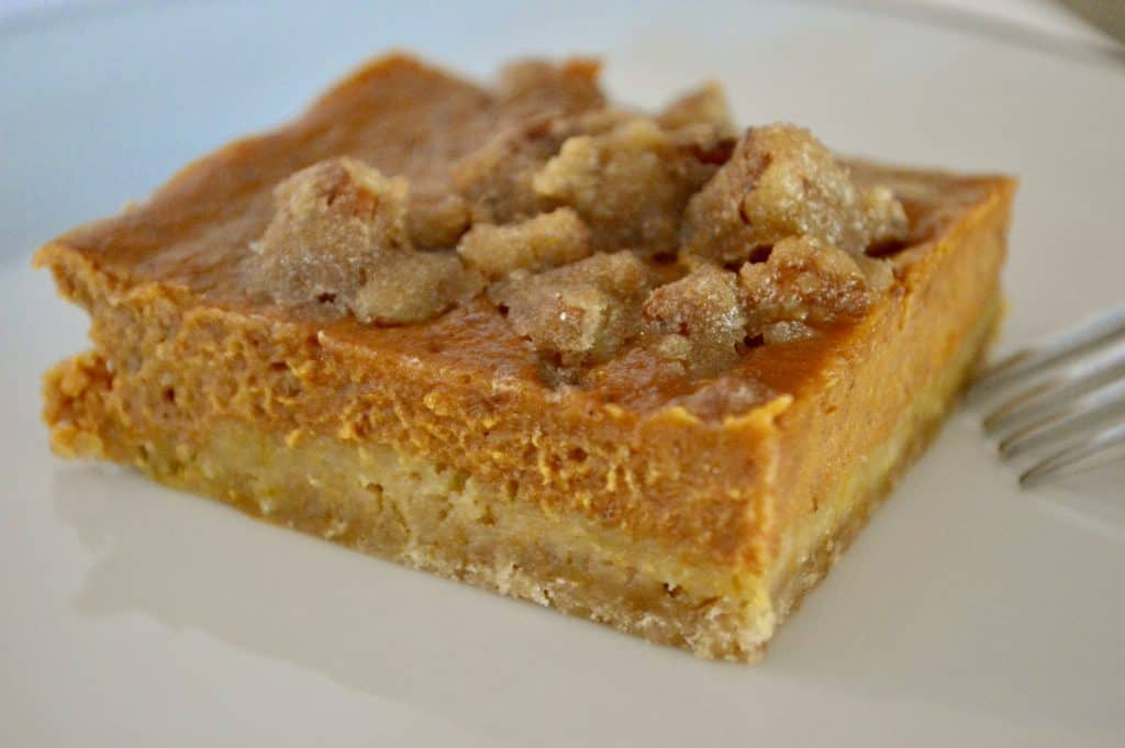 pumpkin pie bars with pecan topping baked in a sheet pan