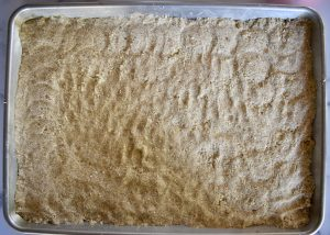 crust pressed into a sheet pan