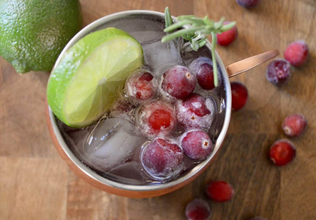 Cranberry Moscow mule with rosemary garnish