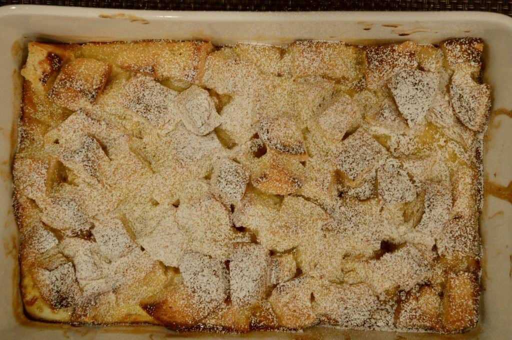 Eggnog French toast casserole bake with powdered sugar on top