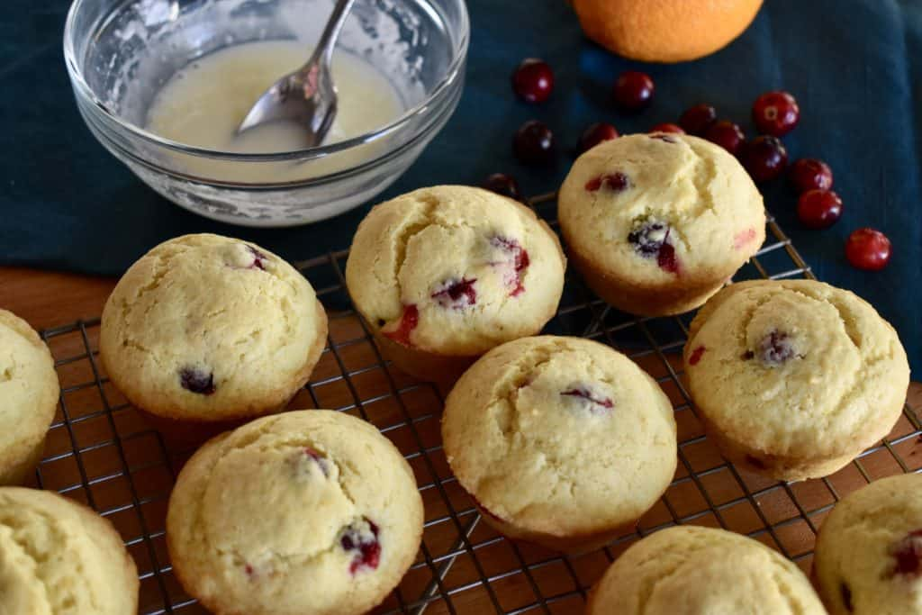 Cranberry orange muffins with glaze on the side.