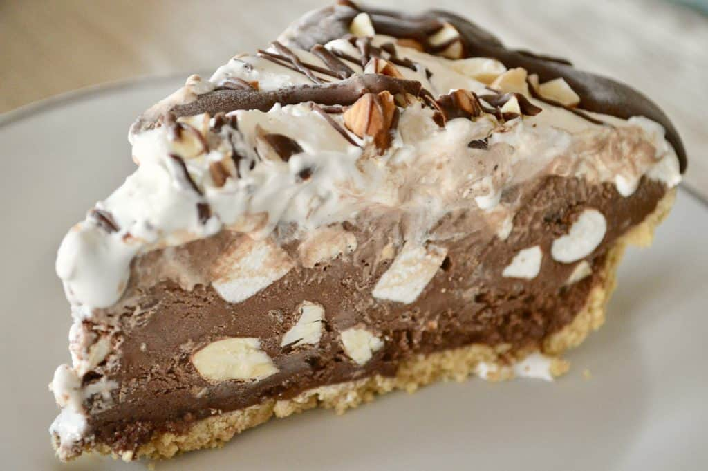 Rocky Road Ice Cream Pie on a white plate.