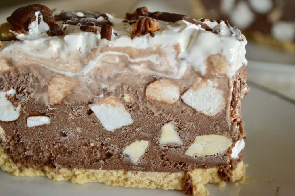rocky road ice cream pie with large chunks of almonds and mini marshmallows in chocolate ice cream