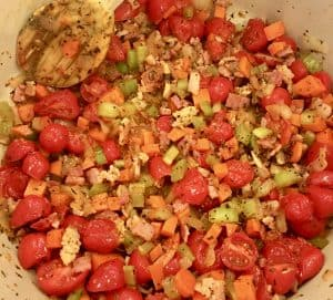 tomatoes, bacon, and mirepoix cooking for pasta e Fagioli Soup