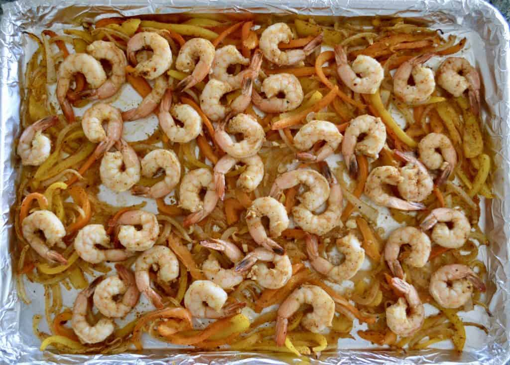 Sheet Pan Shrimp Fajitas on a foil lined baking sheet
