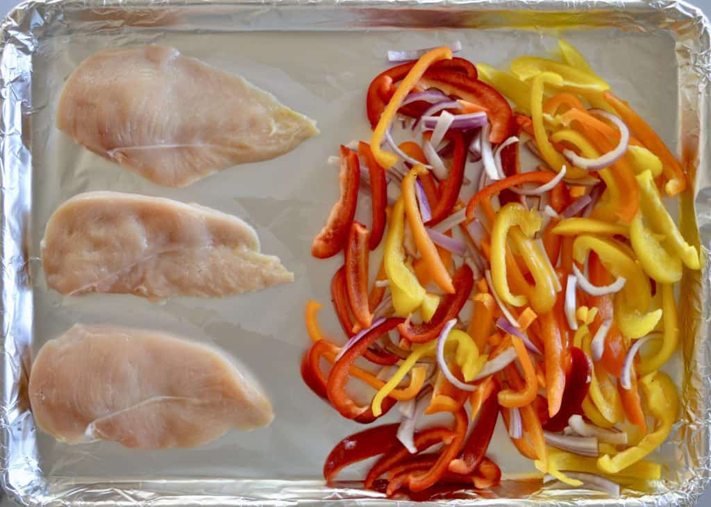 cook the chicken and bell peppers on a foil-lined baking sheet