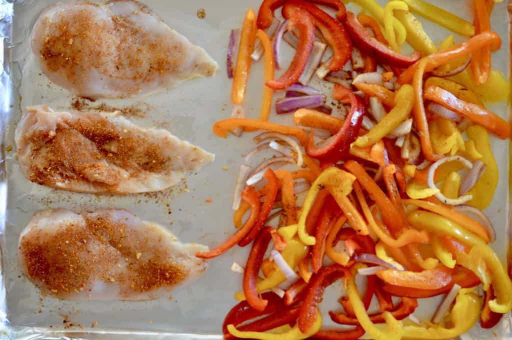 sprinkle taco seasoning on the chicken and bell peppers
