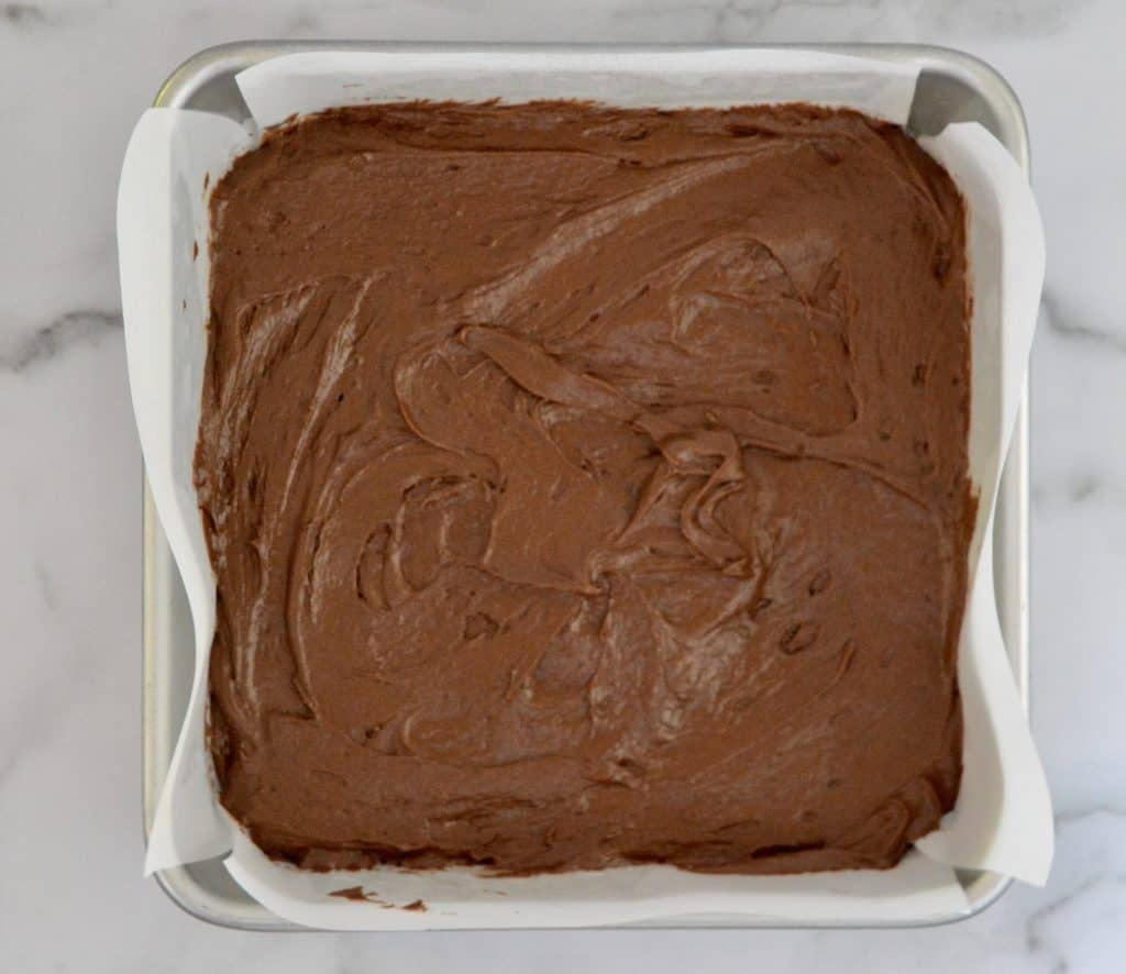 brownie batter in a pan for best Reese's brownies