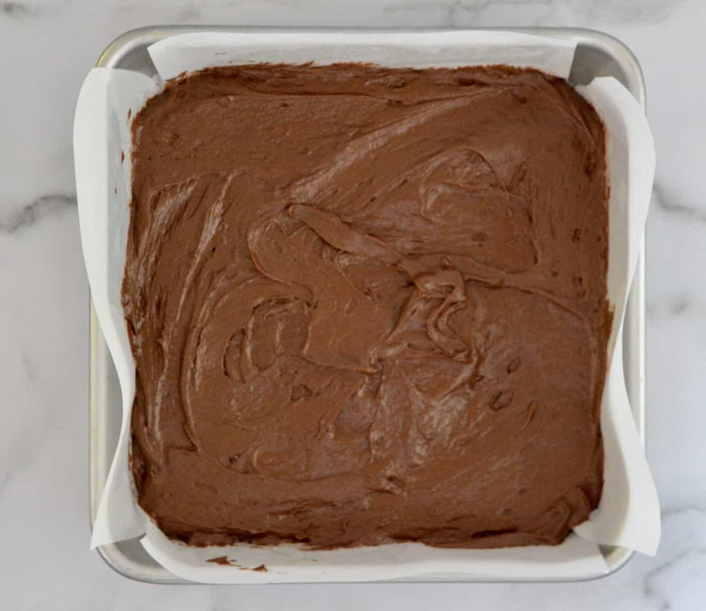 brownie batter in a pan for best Reese's brownies