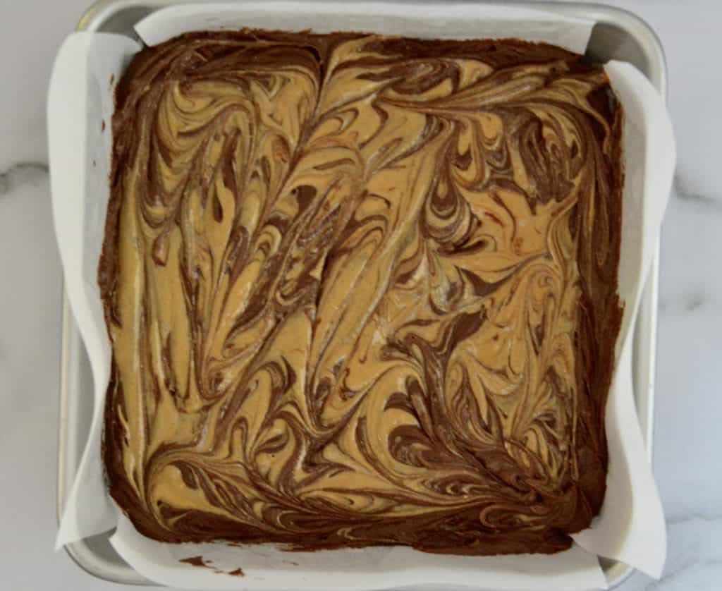 peanut butter swirled atop the brownie layer