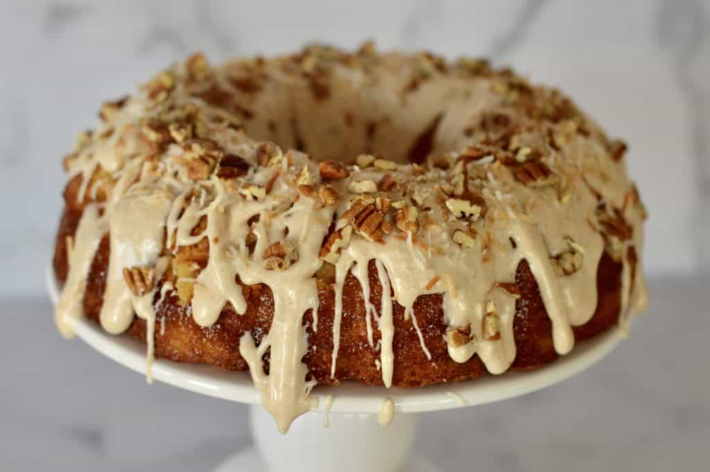 Pineapple Bundt cake topped with cinnamon cream cheese frosting