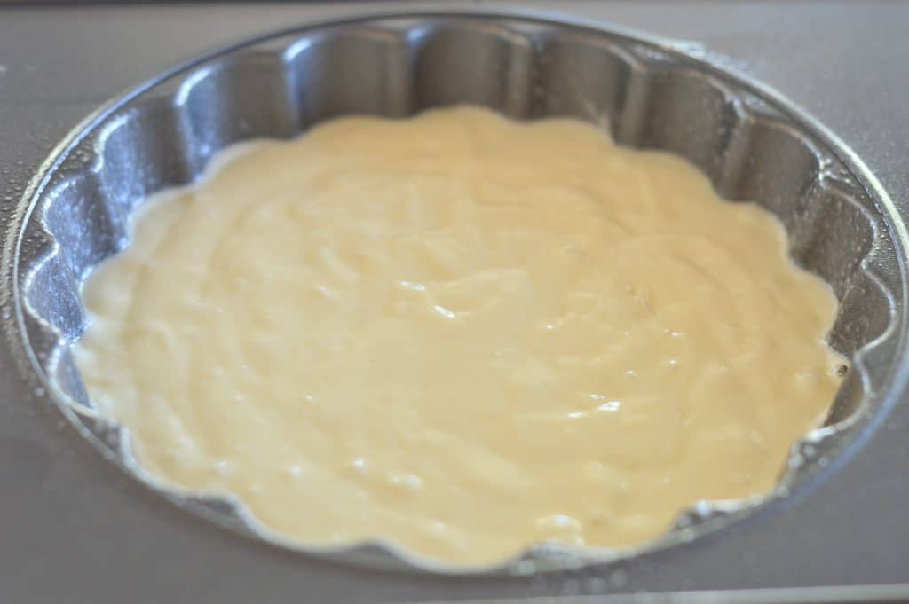 cake batter in the bottom portion of the wilton cupcake cake pan