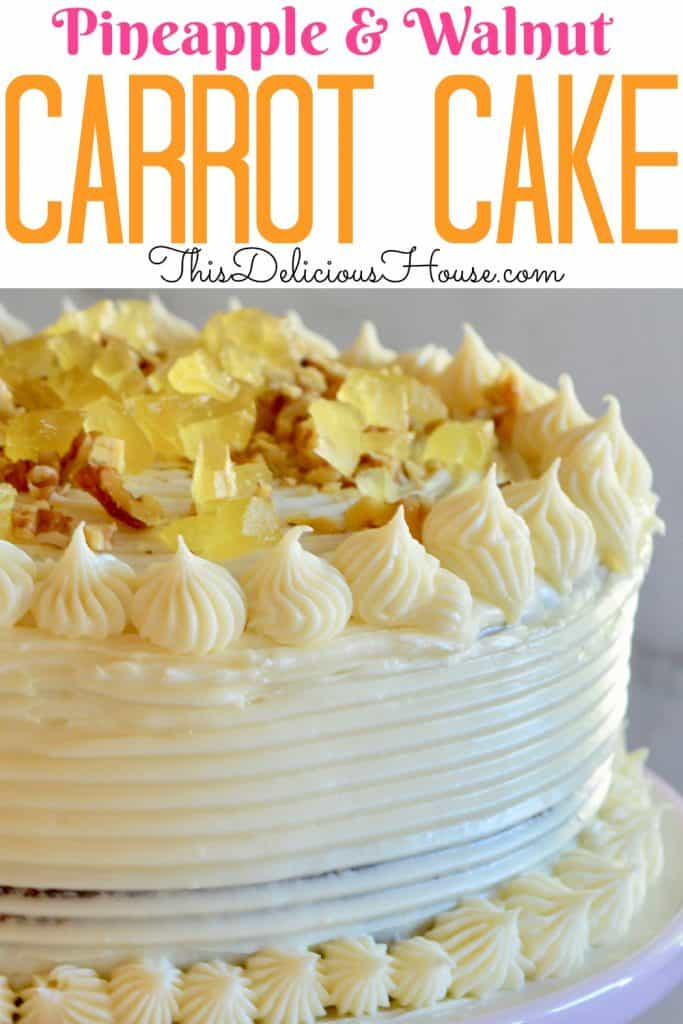 carrot pineapple cake with candied pineapple and walnut topping on a pink pedestal