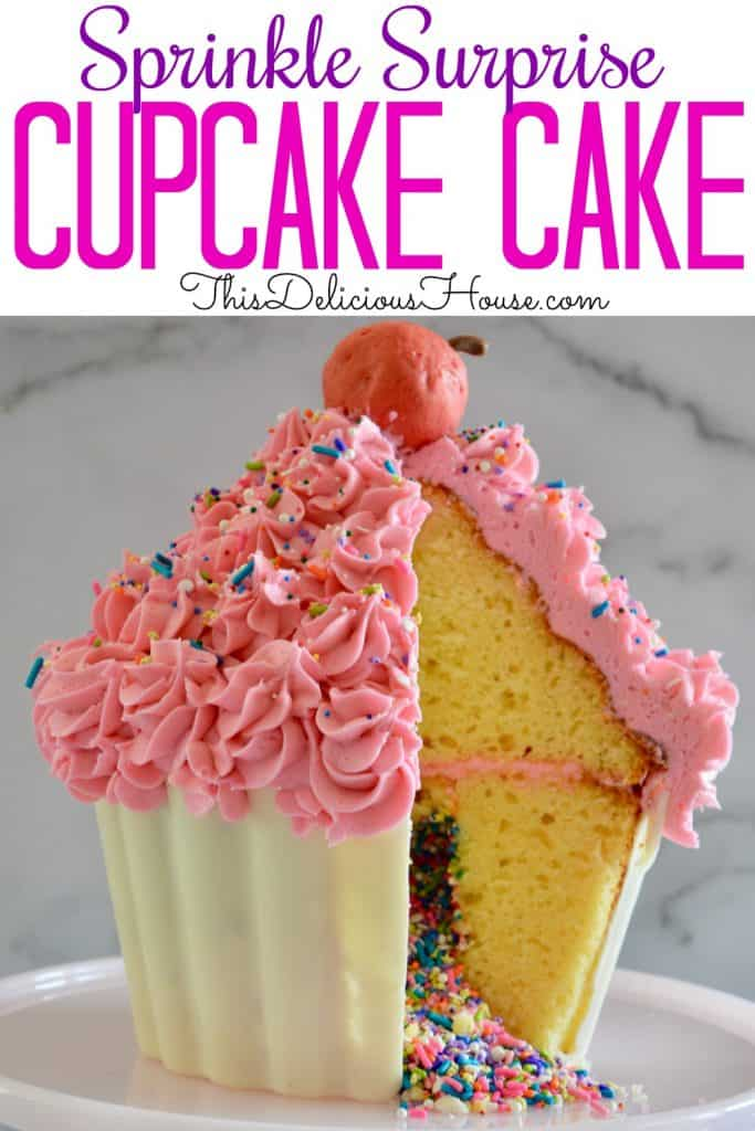 giant cupcake cake with sprinkles in the middle and a truffle cherry on top