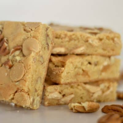 caramel chip pecan bars on a marble counter
