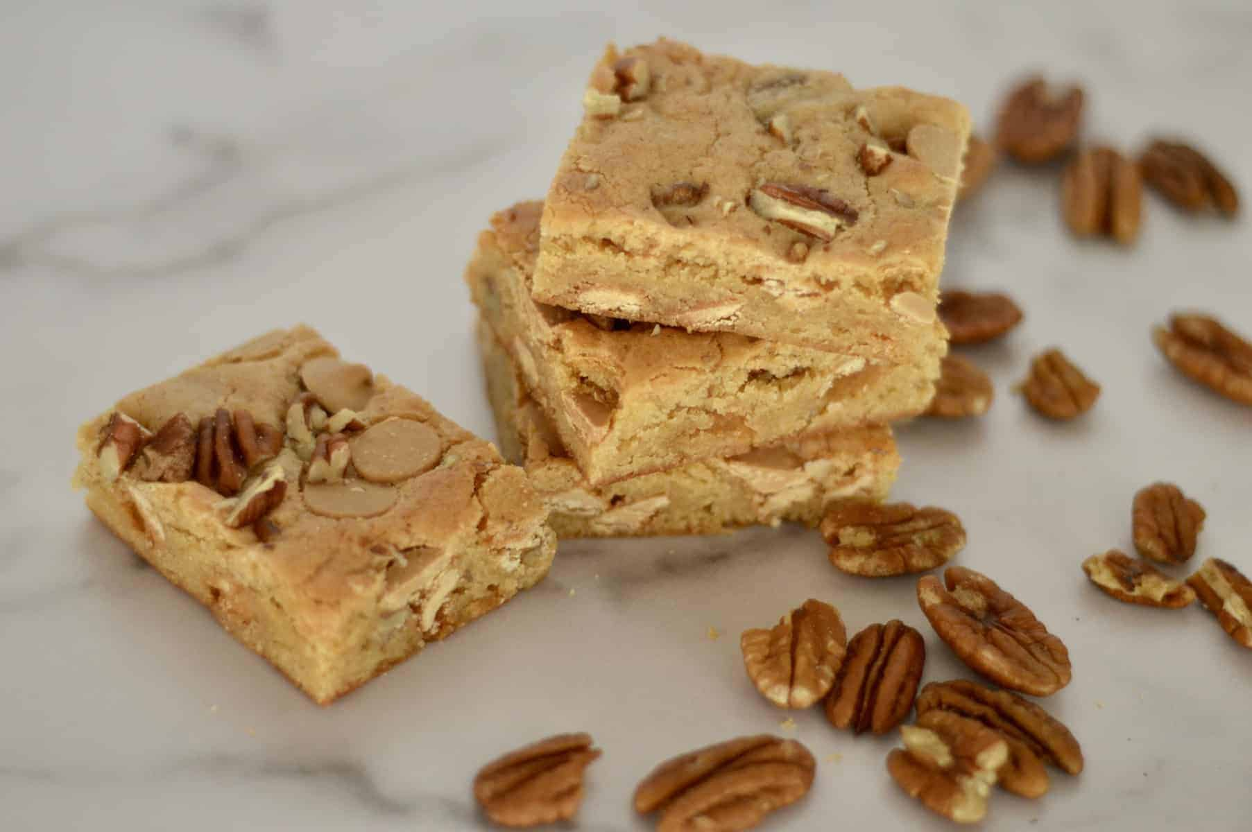 Caramel Pecan Bars stacked on a countertop