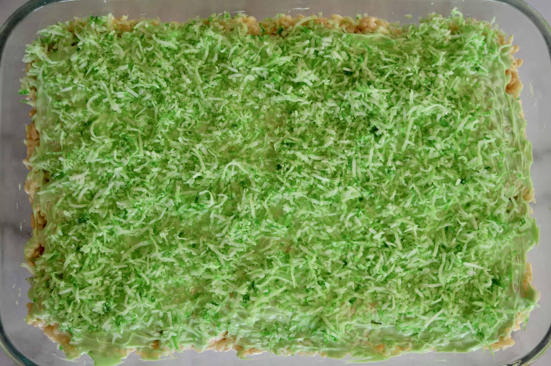 green coconut sprinkled on top of Rice Krispies bars