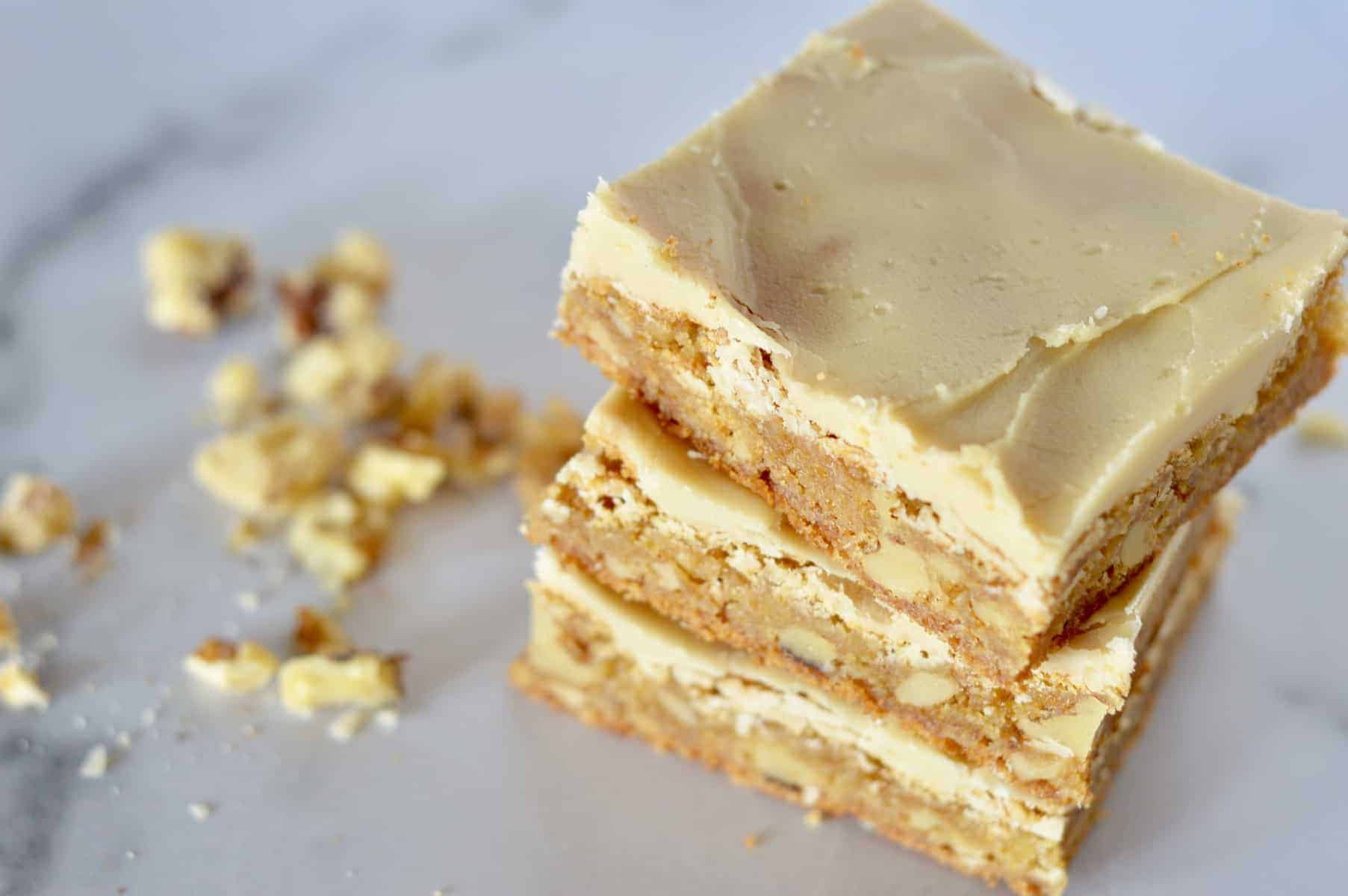 frosted butterscotch blondies stacked on each other