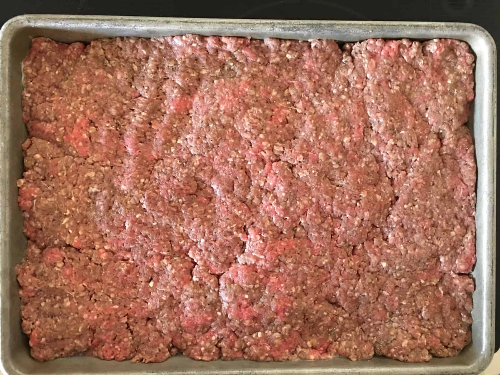 ground beef in a baking pan.