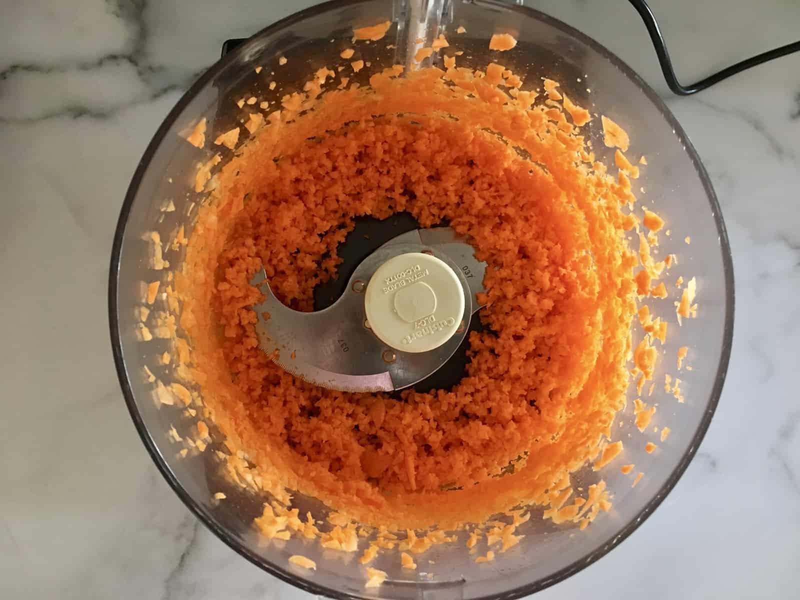 shredded carrot in a food processor