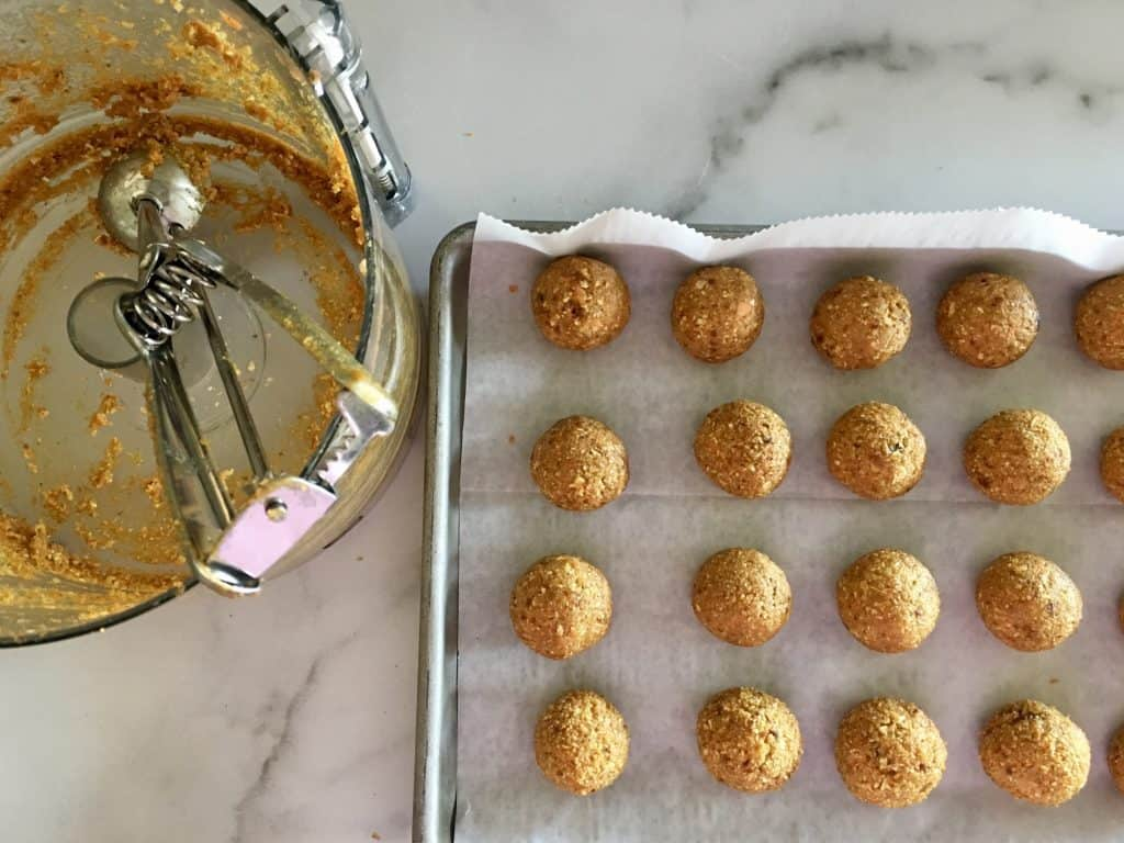 carrot cake energy balls rolled out on parchment