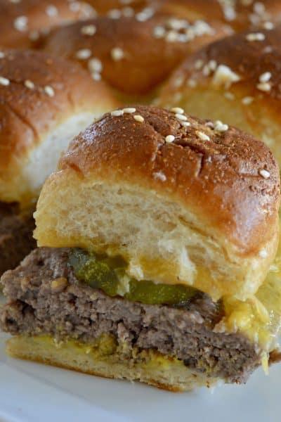 Easy baked cheeseburger sliders on a white plate.