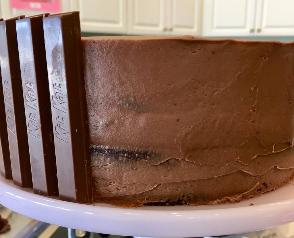 chocolate cake with Kit Kat bars stuck along of the side