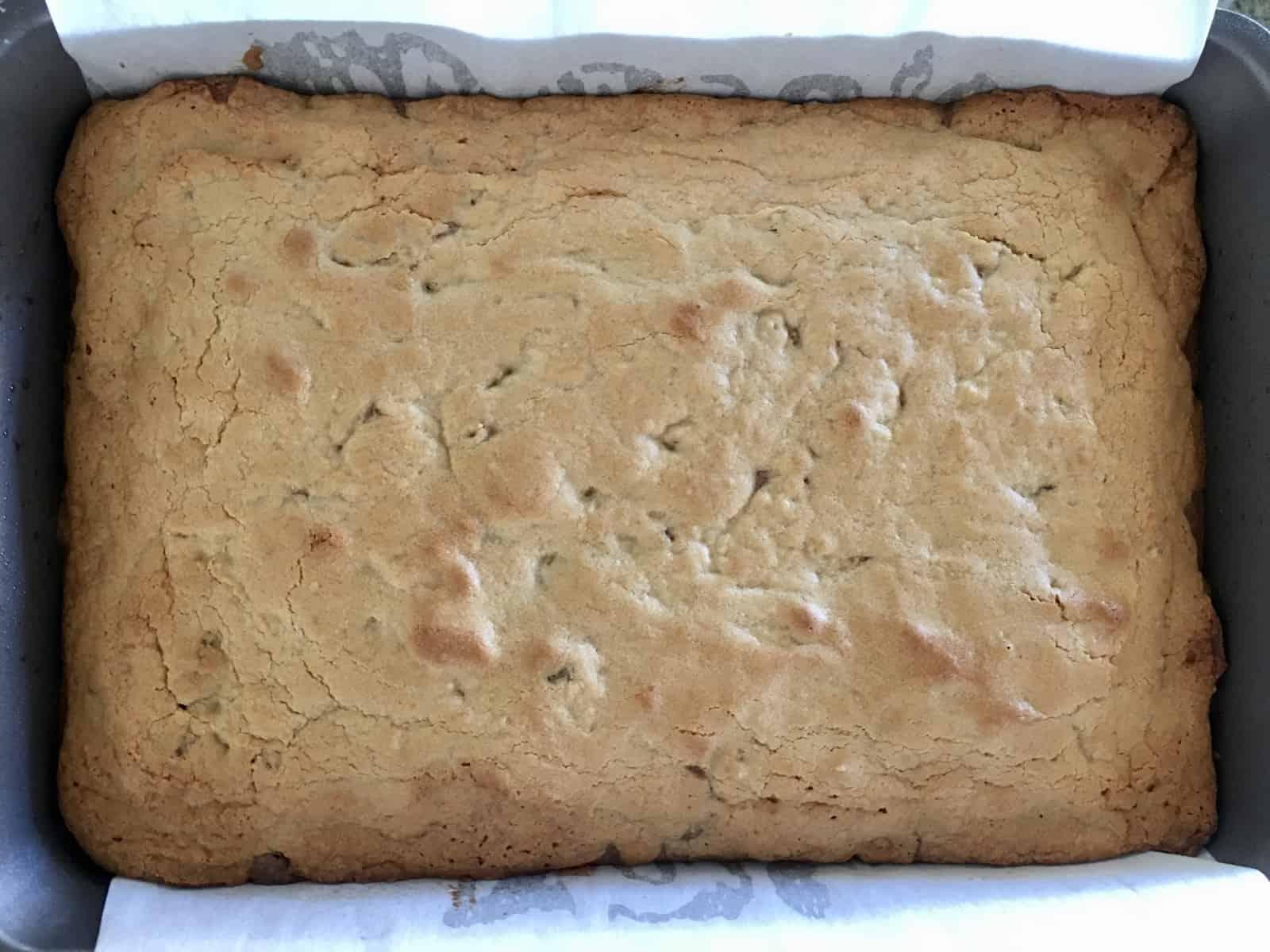 Baked Brownie Blondie Bars in the pan cooling.