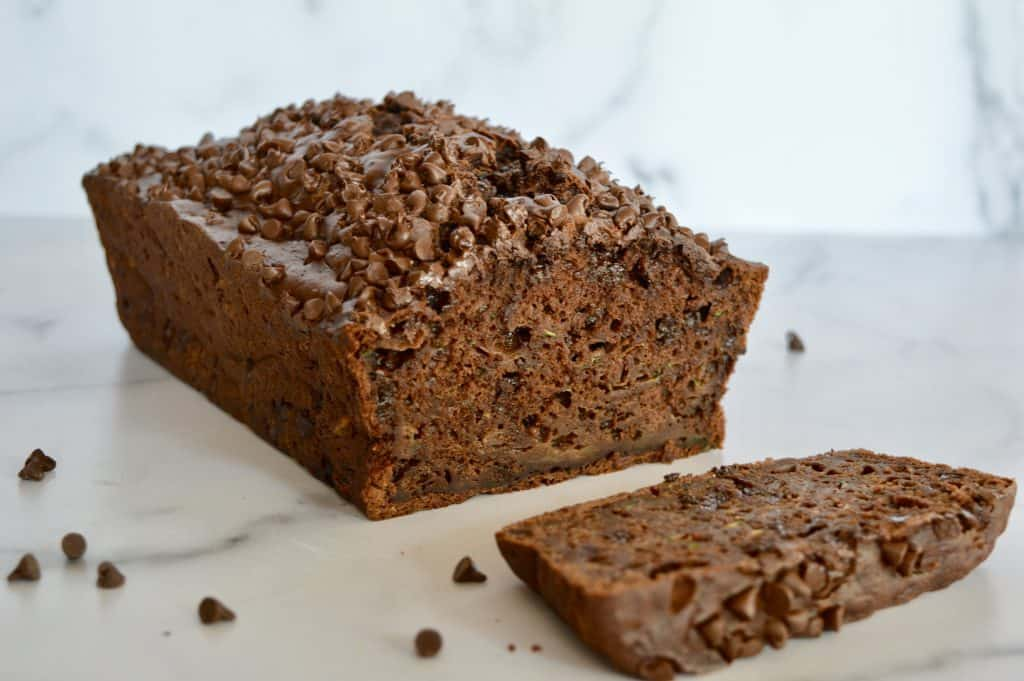chocolate zucchini banana bread on a counter with a slice cut