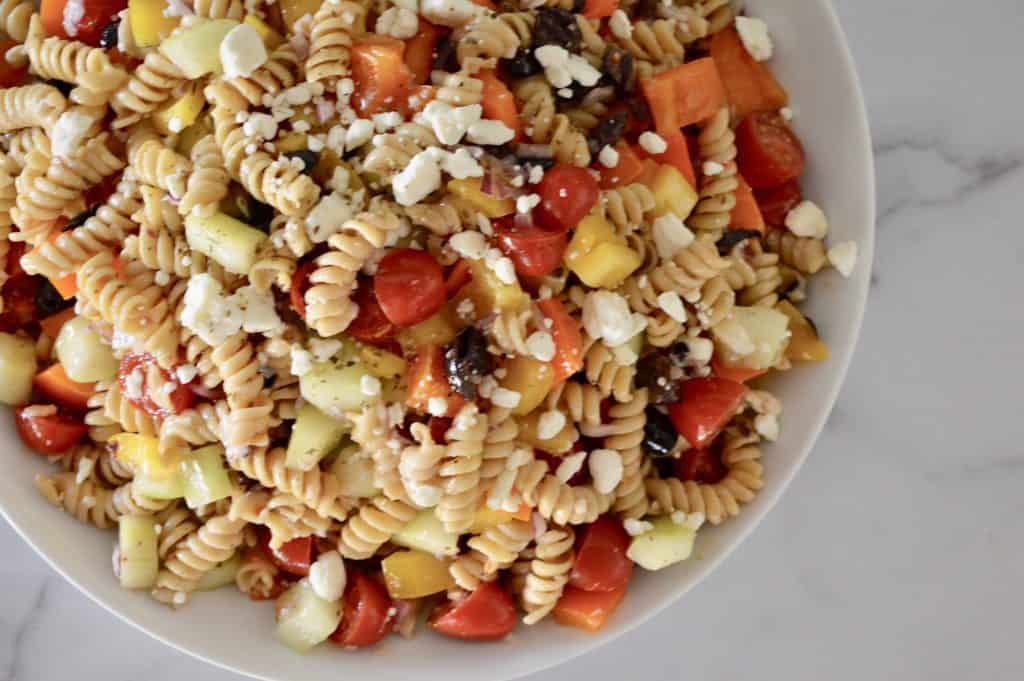 Whole Grain Greek Pasta Salad in a white bowl.