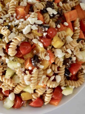 Whole Grain Greek Pasta Salad in a white bowl.