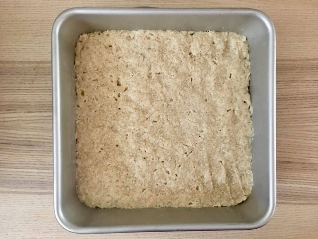 shortbread mixture baked in the bottom of a 9 x 9 inch baking pan.