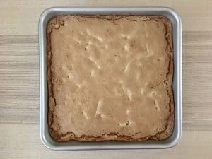 Baked butter tart squares in a 9 x 9 inch baking pan.