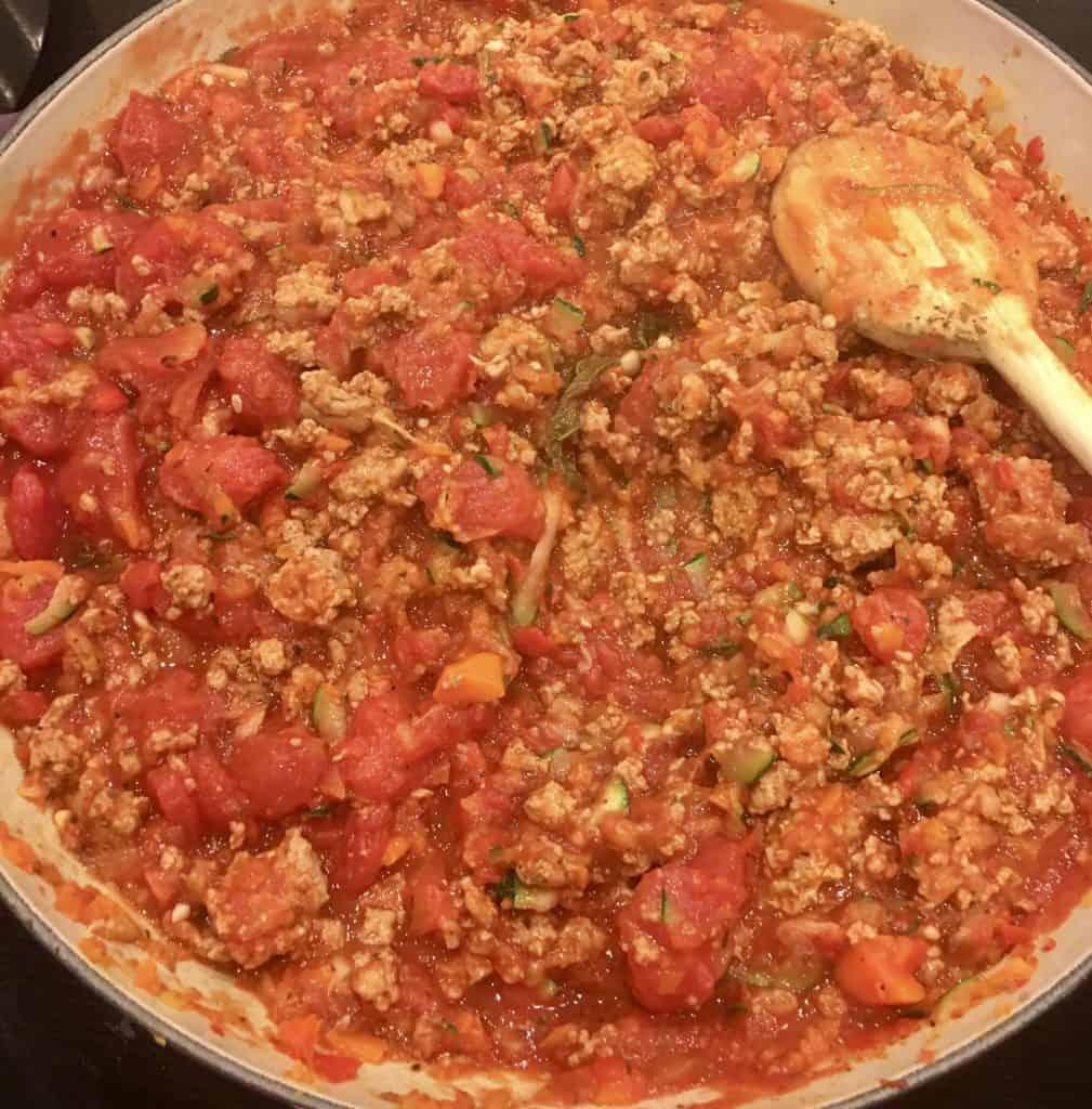 Braiser full of turkey vegetable pasta sauce.