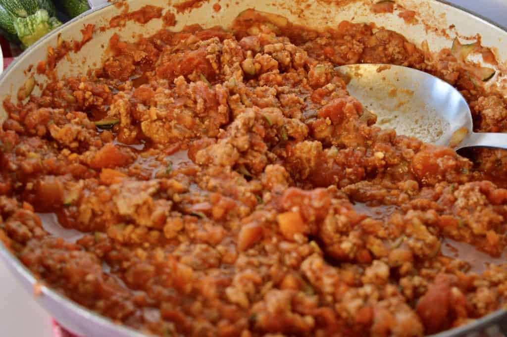Close up of skillet with turkey vegetable sauce.