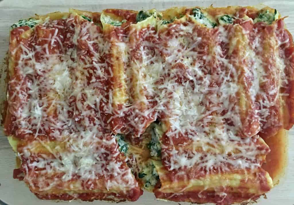 turkey and spinach manicotti in a glass baking dish .