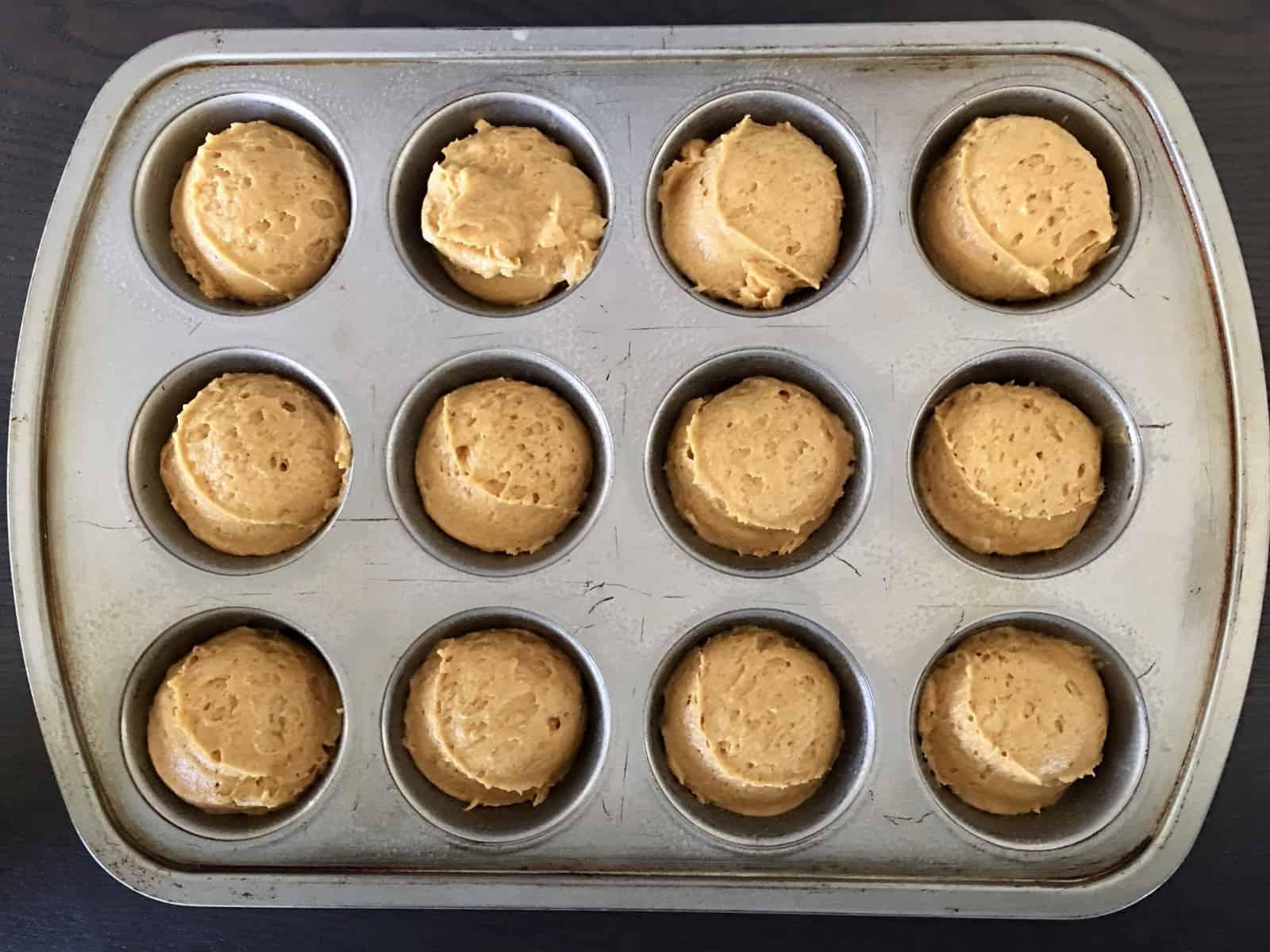 batter in muffin tin.
