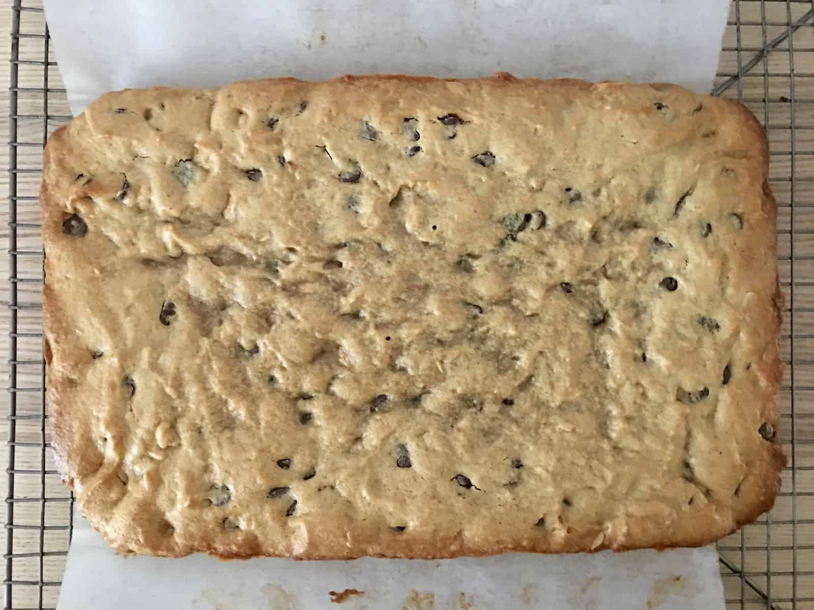 peanut butter banana blondies in a glass baking pan lined with parchment.