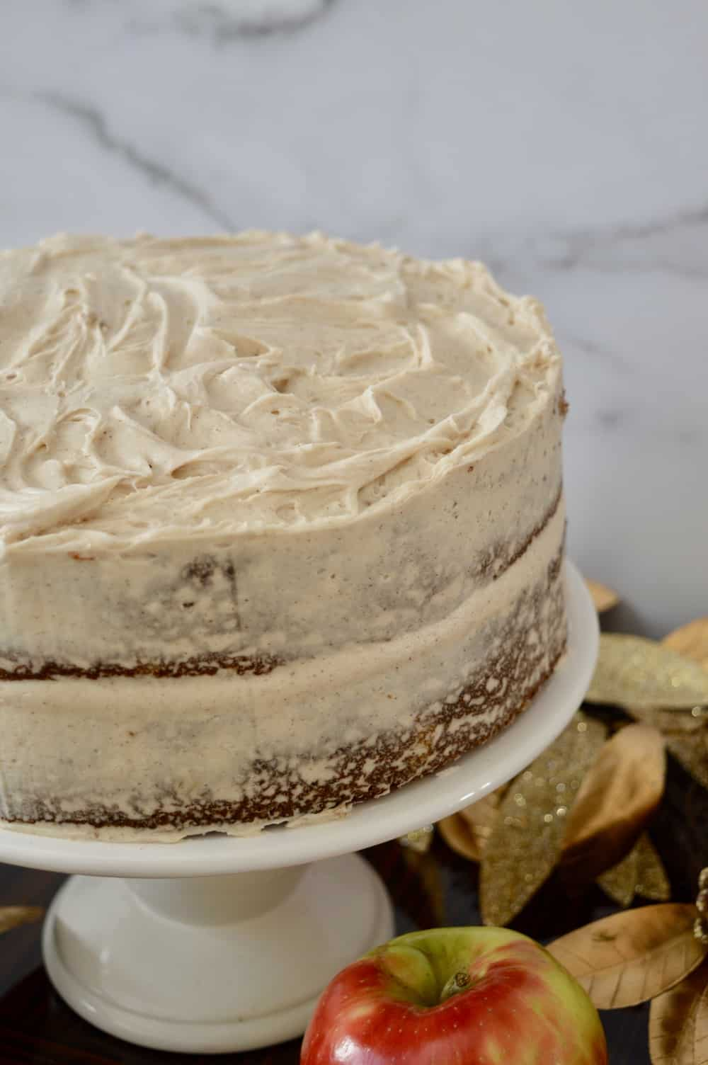 use bench scraper to great naked effect on the cake.