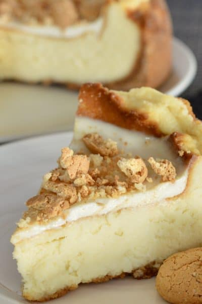Amaretto Mascarpone Cheesecake on a plate with amaretti cookies.