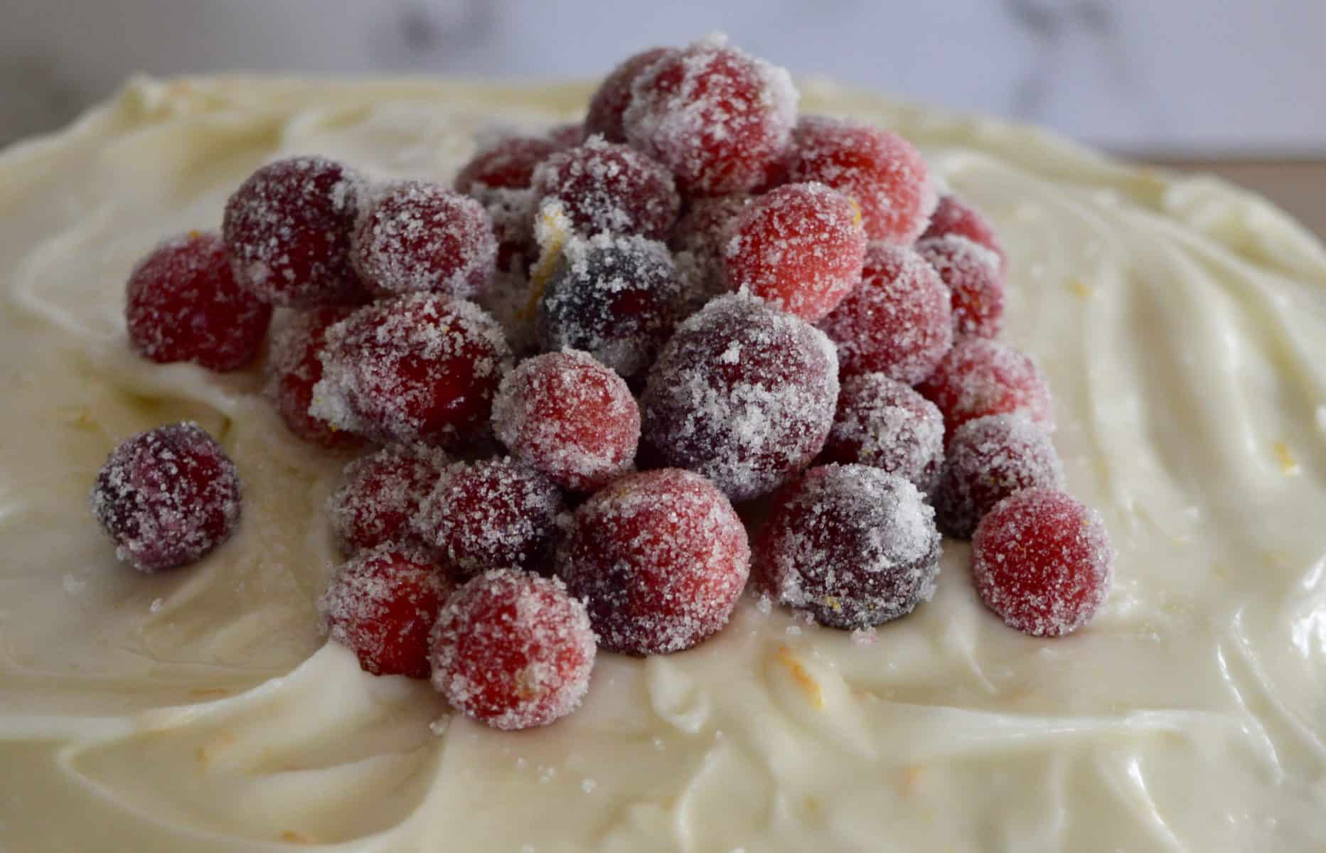 sugared cranberries on top of the frosting.