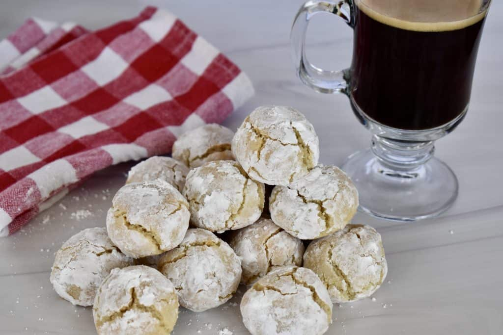 Amaretti Cookies stacked on a table.