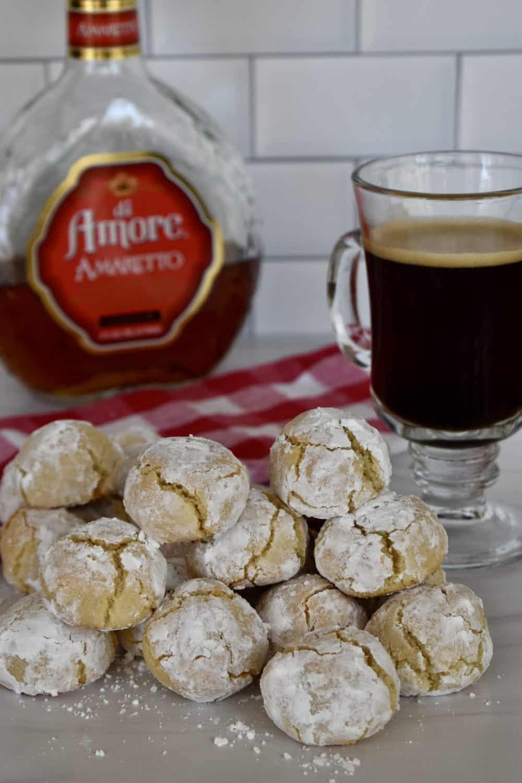 Amaretti Cookies with Amaretto liqueur in the back.