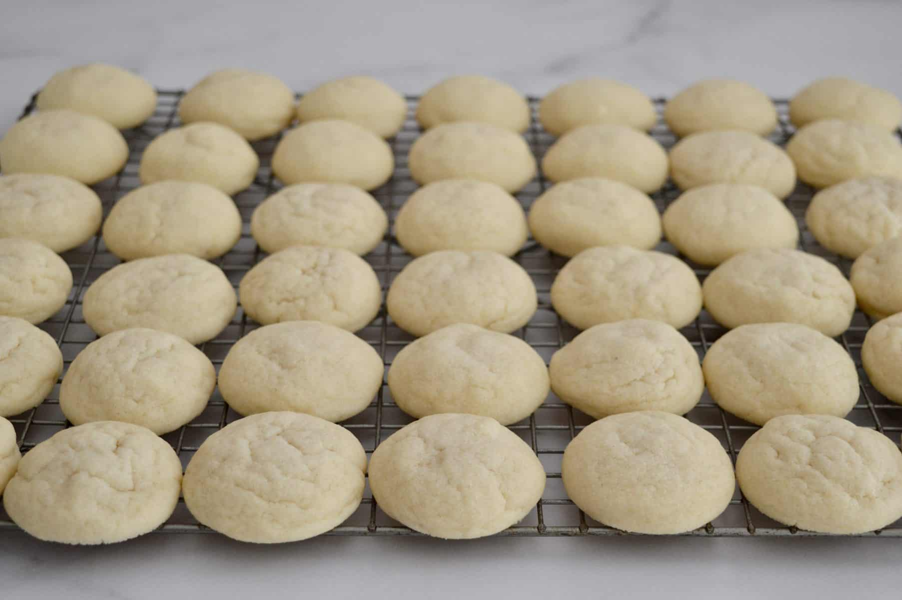 Greek Butter cookies cooling on a wire cooling rack.
