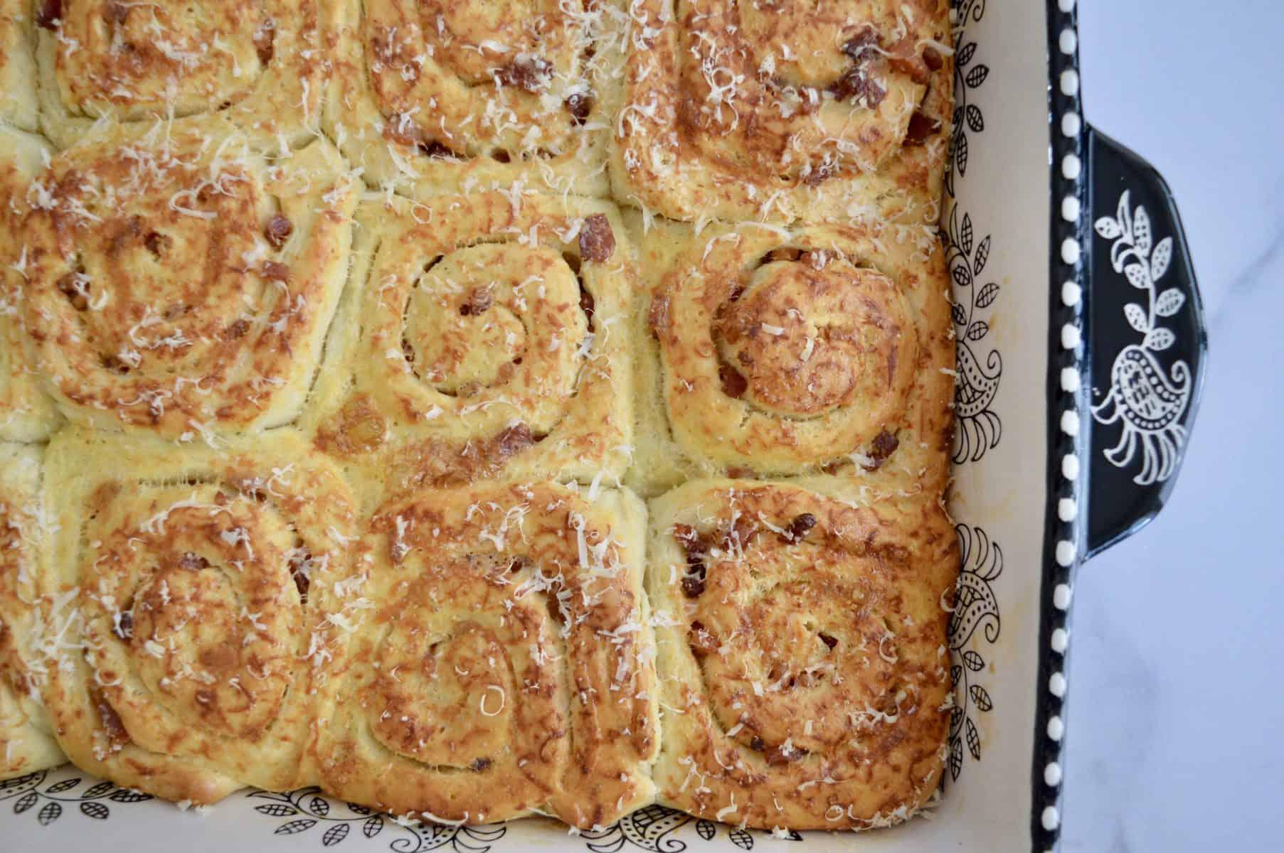 Pinwheel Bread rolls in a baking pan.