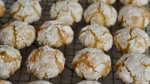 Amaretti Cookies cooling on a wire baking rack.