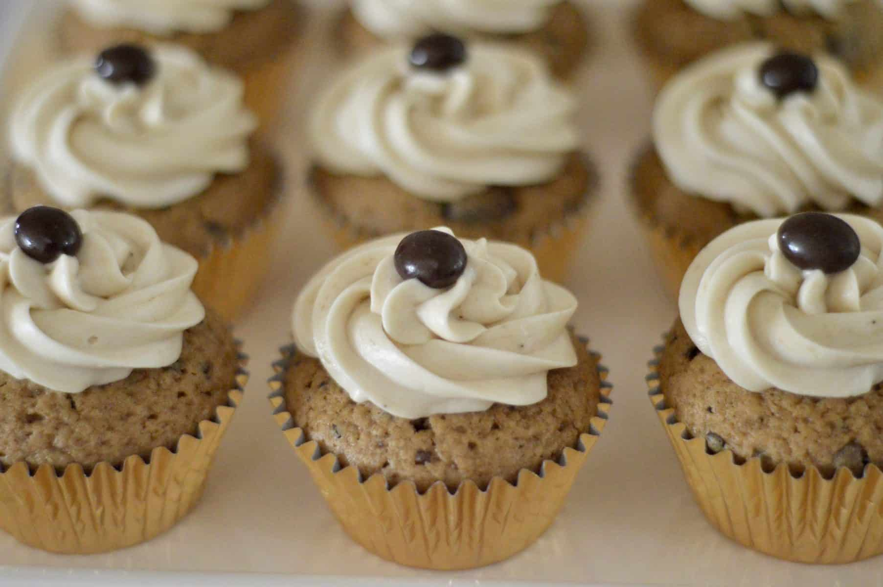 Espresso Cupcakes with Espresso Cream Cheese Frosting and a chocolate-covered espresso bean on top.