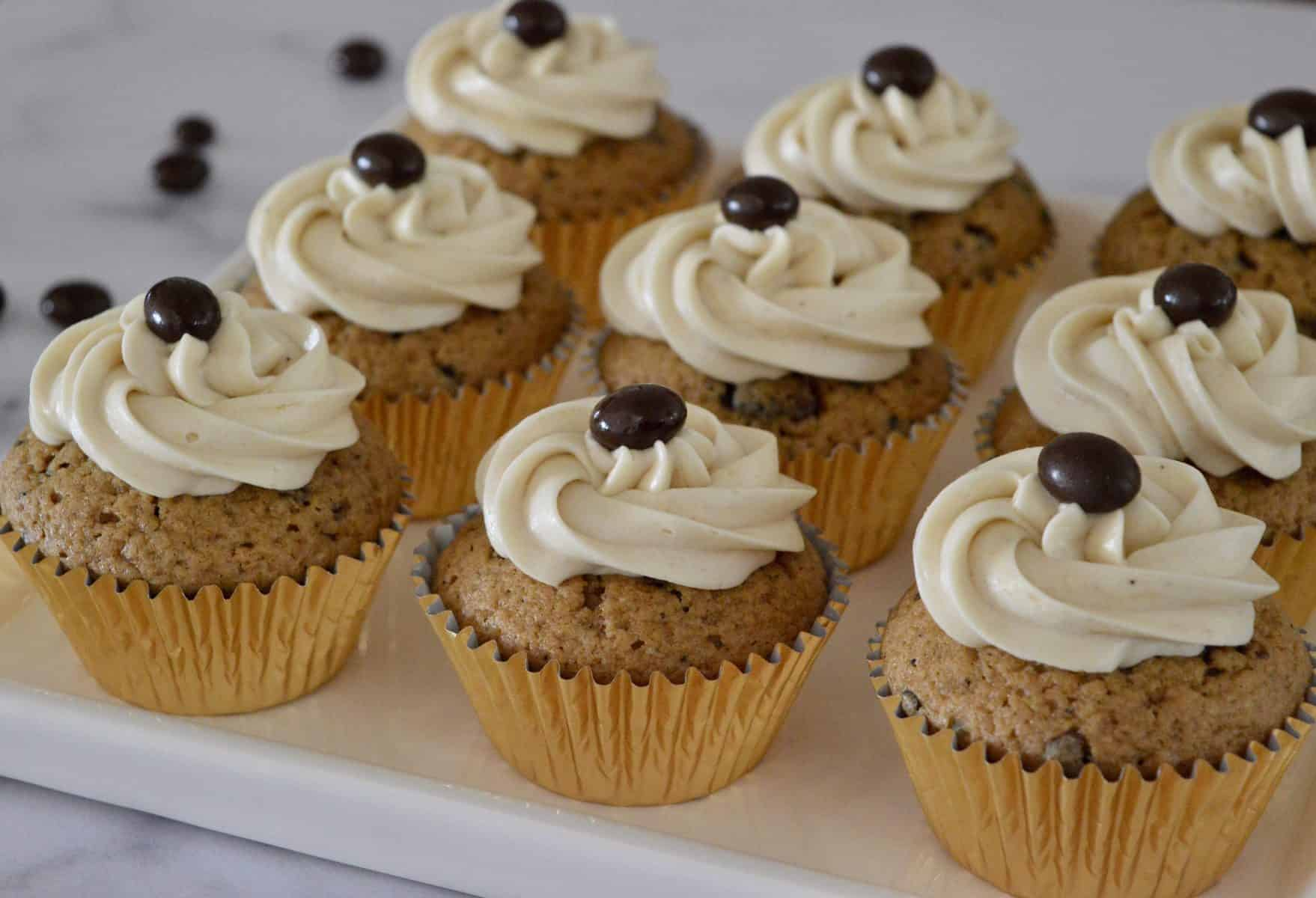 Espresso Cupcakes with chocolate covered espresso beans on top.