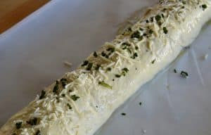 dried basil and parmesan sprinkled over top of Stromboli before baking.